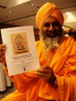 The eminent Sikh environmental leader Balbir Singh Seechewal holds the 'Guidebook to Creating Your Own EcoSikh 5-year plan'