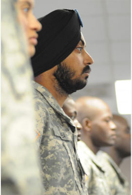 Spc. Simranpreet Lamba joins 12 other Soldiers in a naturalization ceremony