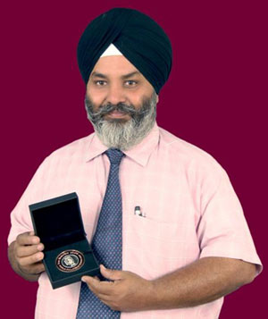 S. Paramjeet Singh with his 'Large Silver Medal', won early this year.