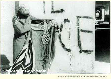 Sikh soldier holds a captured Nazi flag