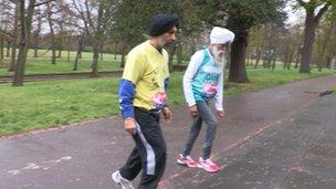 Fauja Singh with his trainer Harminder Singh