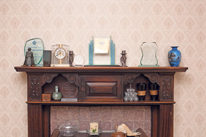 Mantelpiece, holding ornaments and various awards
