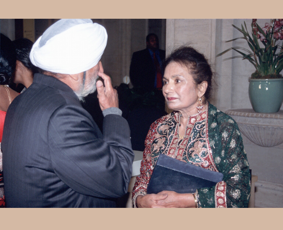 Satinder Kaur speaking with a guest at the Asian Art Museum opening Gala of the Sikh Gallery in 2003