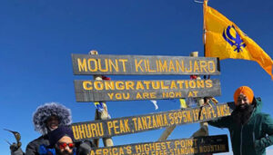 Flying the Nishan Sahib on Mt. Kilimanjaro