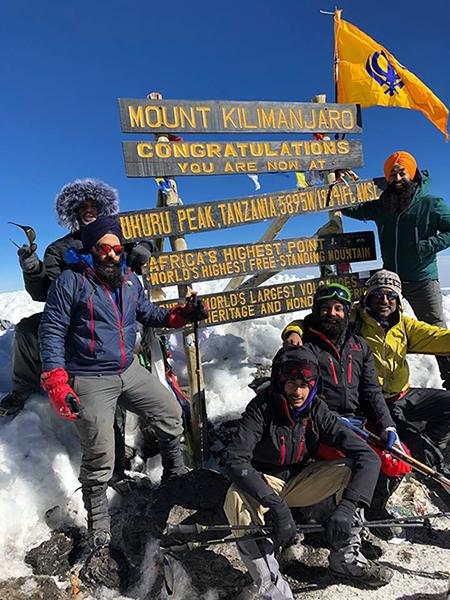 Flying the Nishan Sahib on Mt. Kilimanjaro